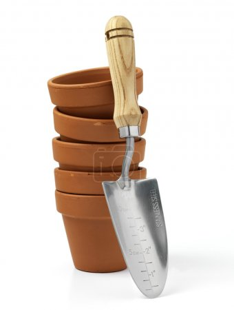 Terracotta pot and trowel