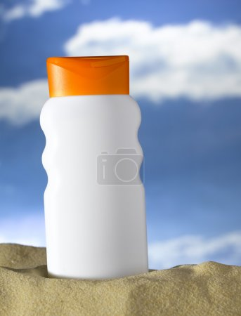 Lotion bottle on a beach