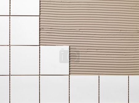 Photo for Tile Adhesive and tiles wall background - Royalty Free Image