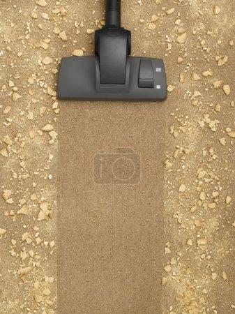 Photo pour Aspirateur nettoyage du tapis avec place pour le texte - image libre de droit