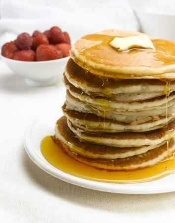Table with Pancakes on white plate...