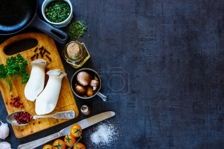 Photo for Dark kitchen table with fresh ingredients for cooking. Vintage background with space for text, banner, top view. Healthy food, vegan or diet nutrition concept. - Royalty Free Image