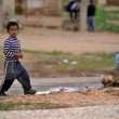 Many children returning into Konbane with their pa...