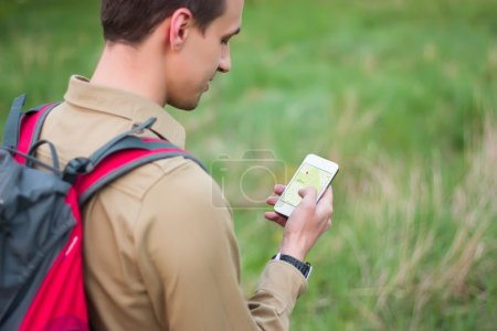 Tourist using navigation app