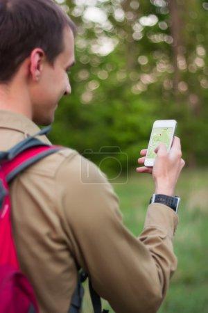 Tourist using navigation app