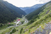 Photo of capra peak and famous winding road in fagaras mountains at sunset, Romania.