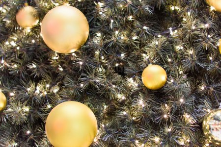 Golden balls on decorated christmas tree