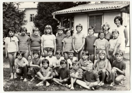Vintage photo shows teenagers and female chiefs at summer camp.