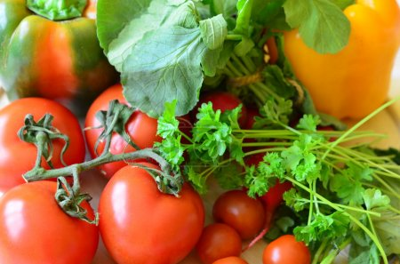 Tomatoes, radishes, peppers, parsley and wickerwork handbasket