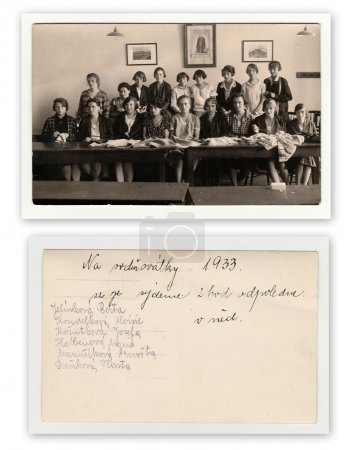 Front and back of photo. A group of girls in classroom (1933). Vintage photo