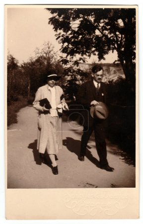 Photo for THE CZECHOSLOVAK REPUBLIC, CIRCA 1930s: Vintage photo shows mother and her son who go for a walk, circa 1930s. - Royalty Free Image