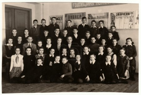 Vintage photo shows pupils (schoolmates) and teaching staff.