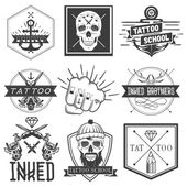Vector set of tattoo school emblems logos banners labels or badges Monochrome skulls anchors fist in vintage style Isolated inked brothers stickers