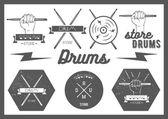 Vector set of vintage style drums labels emblems and logo Music design elements drum drumsticks hand snare