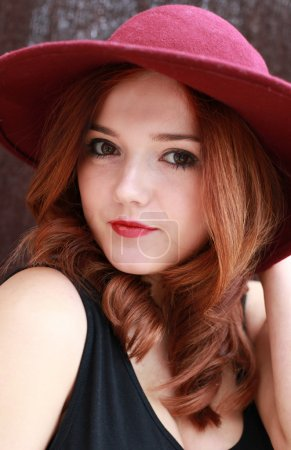 Beautiful red head girl in floppy hat