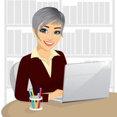 successful young businesswoman working typing on her laptop at office