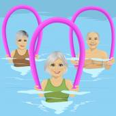 Senior people in fitness class doing aqua aerobics with foam rollers in swimming pool at leisure centre