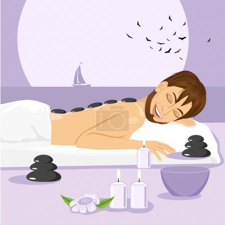 Illustration for Handsome man having stone massage in spa salon. Healthy lifestyle - Royalty Free Image