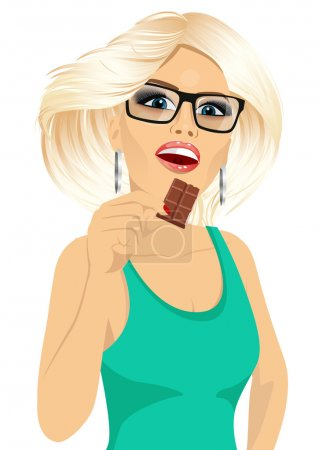 Illustration for Portrait of attractive blonde woman with glasses eating a milk chocolate bar isolated on white background - Royalty Free Image
