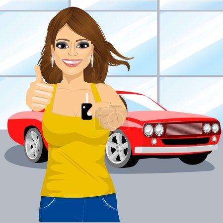 Illustration pour Jeune femme attrayante tenant la clé d'une voiture rouge flambant neuve et montrant pouces dans la salle d'exposition de la voiture - image libre de droit