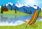 woman sunbathing on lounge chair beside a lake located at the foot of a mountain