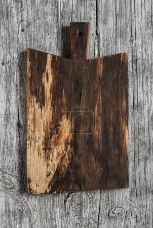 Photo for Chopping cutting rustic board on light wooden background - Royalty Free Image