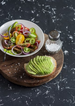 Photo for Simple tomato salad and avocado sandwich. Healthy snack - Royalty Free Image