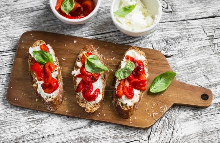 Toast with feta cheese, red roasted peppers and Basil