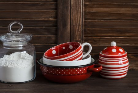 Kitchen still life. Glass jar with flour and vintage crockery -  mug, bowl, jar and pan