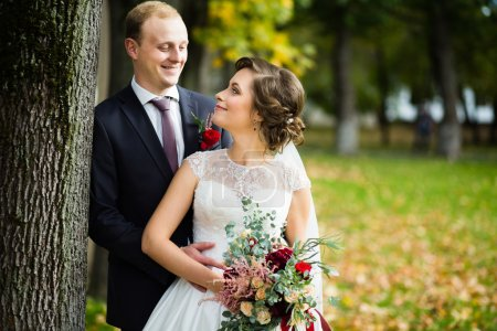 Beautiful bride and groom in the park on a sunny day