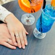 Jewelry concept - hands of couple with ring in res...
