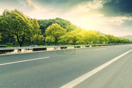 Photo for Automotive advertising background .forest highway Road background or texture - Royalty Free Image