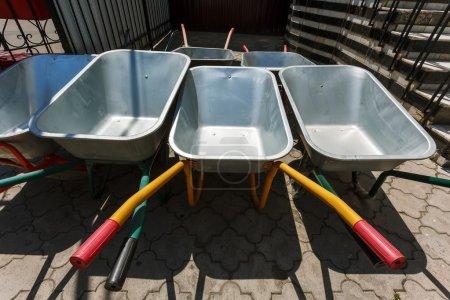 new wheelbarrows piled in row