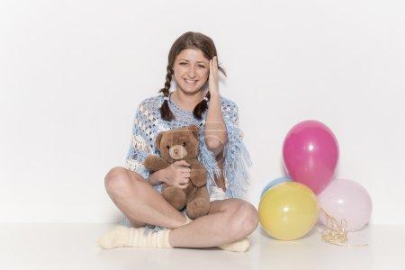 Girl with teddy bear and balloon