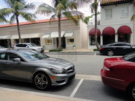 Very expensive cars parked on a street in Palm Beach