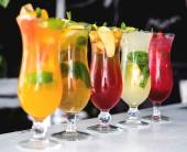 Refreshing cocktails with lime, mint, orange and strawberry
