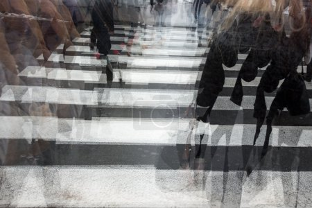 Photo for People crossing a road, hurrying, blurred motion - Royalty Free Image