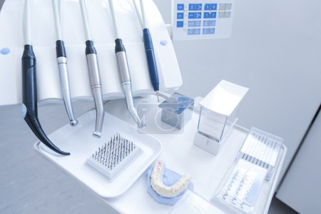 Dental treatment tools with nozzles