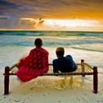 A romantic couple on honeymoon enjoying a breathta...