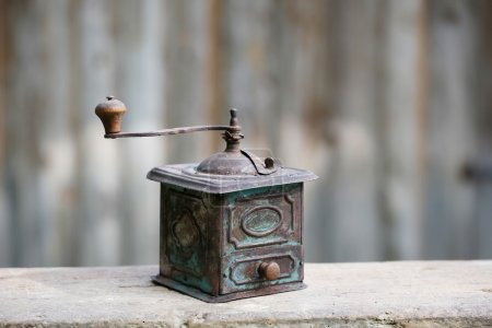 Photo for Hand-operated old copper coffee or spices grinder with drawer on vintage background. Retro nostalgia, home decoration concept. - Royalty Free Image