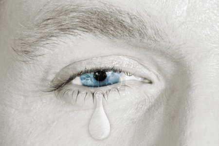 Photo for Crying blue eye on black and white face. concept of sadness, fear,love pains, mental depression disease,  eyewash and eye health - Royalty Free Image