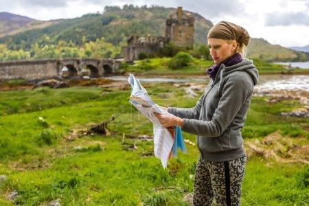 Woman visiting Scottish Castle