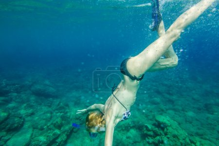 a Female snorkeling