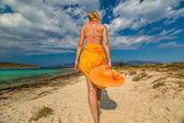 Woman orange dress beach