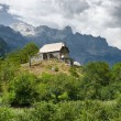House on the hill in Theth valley, Albania...