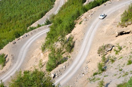 Car, Winding Road And Albanian Mountains