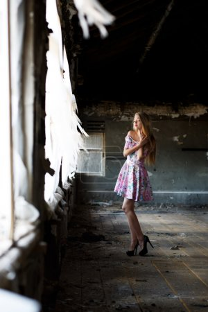 beautiful woman in abandoned house