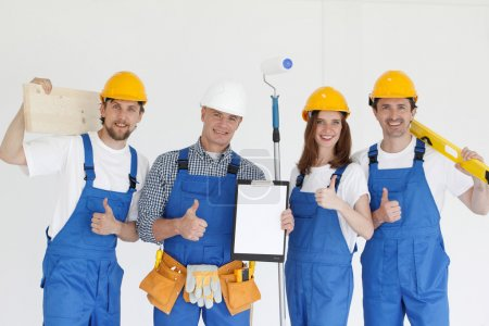 Group of smiling builders