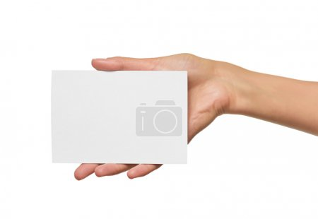 Woman holding blank business card in hand.