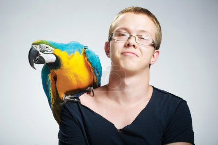 teenage boy with parrot